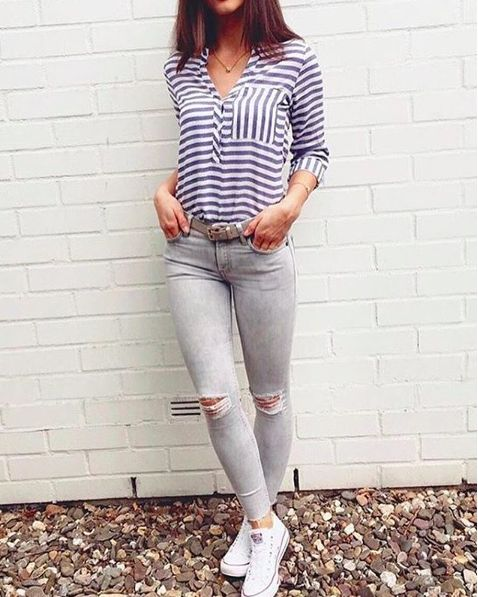 grey ripped jeans with striped blue blouse