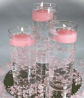 clever use of candles and filler. a nice change from orchids. now where would i find PINK floating candles in bulk....