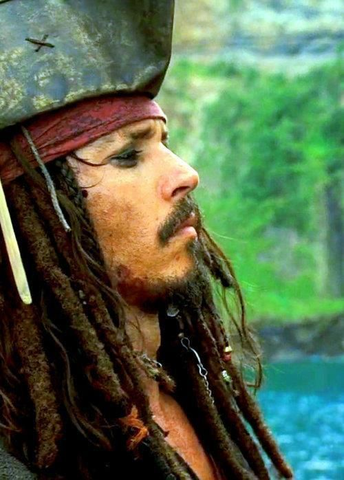 "Johnny Depp as Captain Jack Sparrow in the 2003 film, ""Pirates of the Caribbean: The Curse of the Black Pearl."""