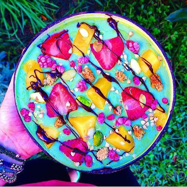 1 frozen banana 1/2 mango 1/2 persimmon  Handful spinach  1 cup almond milk 1/2 tablespoon agave  1/4 teaspoon maca  1/4 teaspoon spirulina  Toppings: mulberries, raw sprouted buckwheat, strawberries, blueberries, mango, raspberries, pistachios, pumpkin seeds, vegan Nutella.  Blend all ingredients together until smooth. Top with fruit, granola or whichever toppings you like