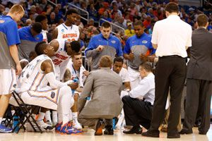 Billy Donovan huddles with his team during Thursday night's NCAA opener against Albany.