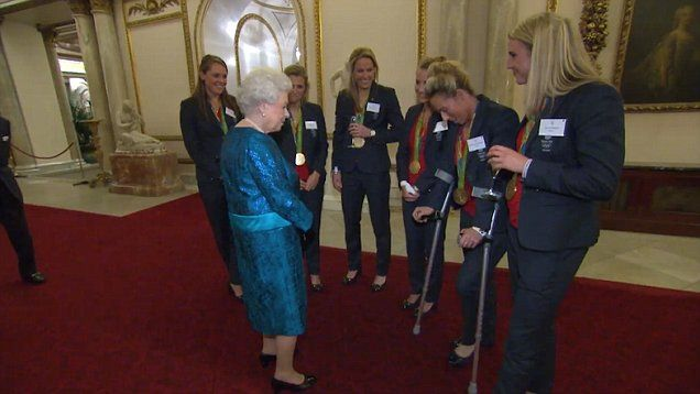 The Queen spotted joking during reception with GB Hockey's Susannah Townsend at Buckingham Palace