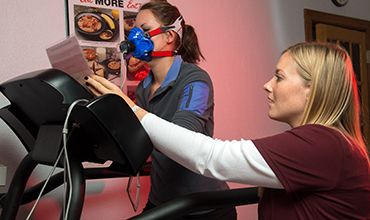 Stephanie Opper taking a test to measure her respiratory fitness at the Army Wellness Center at Fort Meade, Md.
