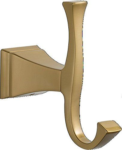 The #Delta 75135CZ is a Dryden Robe Hook in Champagne Bronze. The Delta products combine modern technologies and elegant styling. The #design of the Dryden collec...
