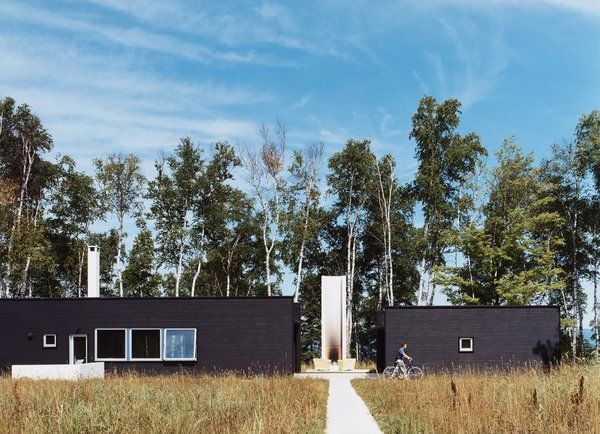 30 All-Black Exterior Modern Homes - Photo 28 of 30 - Two Black Sheds incorporates all the conventional aspects of a weekend retreat in a rather unconventional way.