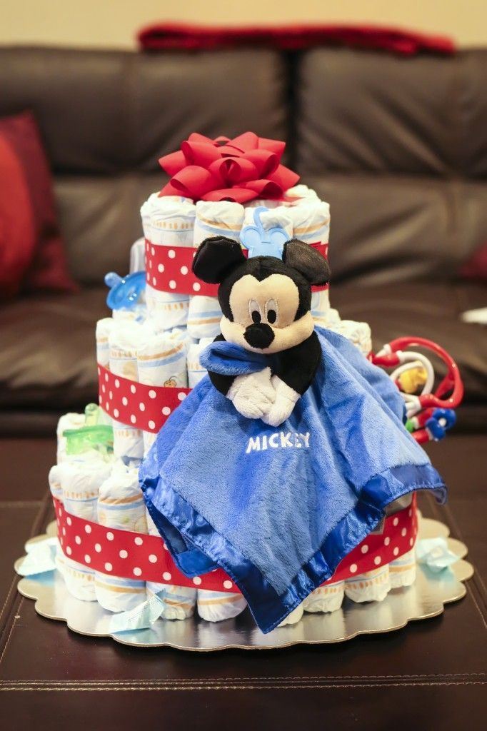 Charming Colorful Disney Mickey Diaper Cake Centerpiece, I Made One Like This One  But I Put A Lot More Mickey Baby Toys On It.