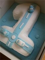 Baby boy Number 1 Birthday Cake : A moist chocolate sponge with chcoclate buttercream, wrapped in white fondant with hand crafted blue cars and roads.  The board has been iced in a baby blanket stitched effect blue fondant with matching buttons :o)