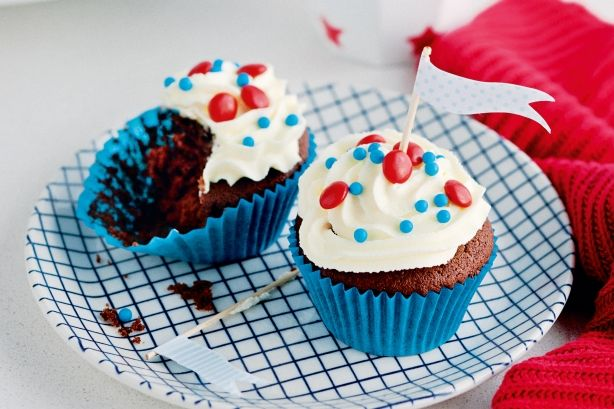 Chocolate cupcakes and white chocolate buttercream - a chocoholic's dream. Try your hand at piping the icing, then go wild with the decorations!