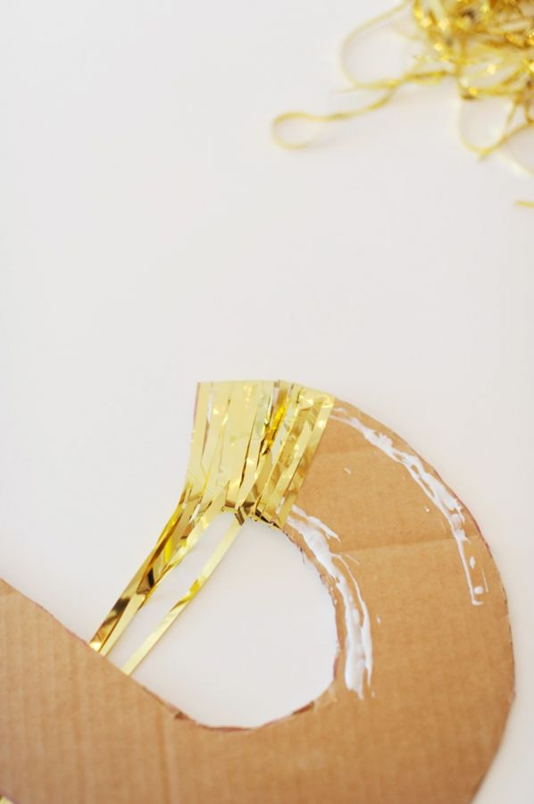 NYE DIY streamer letters use tinsel door curtain to wrap around cut out numbers from cardboard