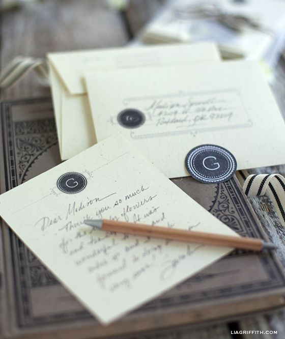 Free printable monogrammed stationary kit. The printable kit includes vintage style cards, an envelope that can be personalized with a name and address and monogram stickers to complete the look.