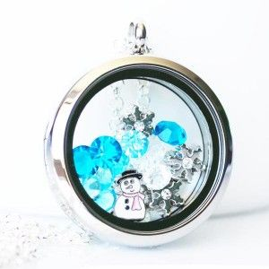 Frozen Theme Locket This locket consist of the following:1x Silver Locket3x Snowflakes1x Snowman11x Mixed Blue and White Birthstones This locket comes on your choice of, Cable, Rolo or Fancy Ball necklace in 18 inch - Please make your selection.