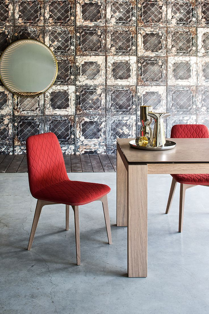 New from Calligaris is the delightful Sami dining chair. Elegantly characterized by its quilted fabric and contrasting cross-stitch, available variety of fabric and leg finishes which makes this chair extremely versatile in it's presentation. #Calligaris #DawsonandCo
