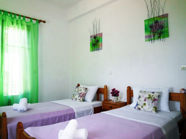 Paraskevi Apartments' bright room in lavender and mint