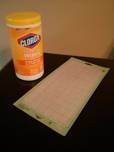 """to restick your mat-All you need is a couple Clorox Wipes and your Cricut cutting mat! I used about 3 wipes and just scraped the mat really well to get all the paper """"fuzzies"""" off. I dabbed it with a paper towel to get the wipe puddles off and let it air dry for about 5-10 minutes."""