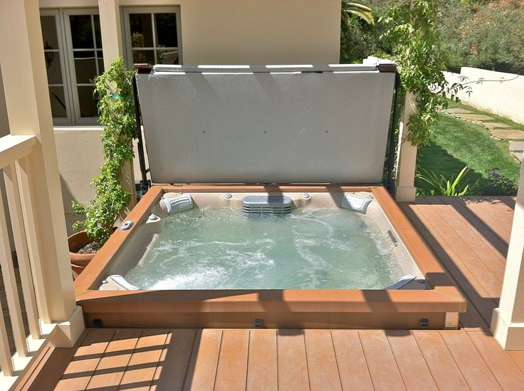 Modern looking jacuzzi jlx spa set in deck www for Free standing hot tub deck