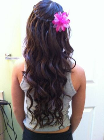 Perfect prom idea! I have a black flower to put in and all I got to do is figure out how to do a waterfall braid!