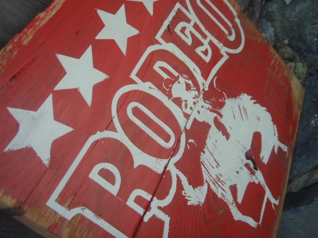 rustic rodeo sign, red rodeo sign, cowboy on horse sign, rodeo nursery, rodeo decor, custom rodeo signs, babes room decor. $30.00, via Etsy.