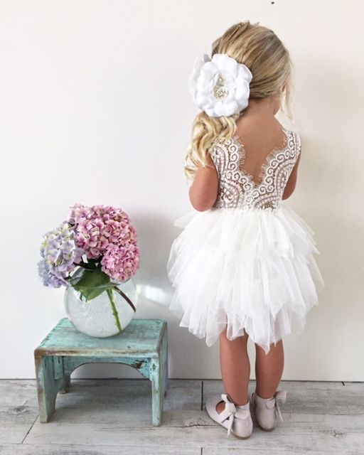THIS ITEM IS A PRE-ORDER and DUE ROUGHLY LATE FEB THEN THEY WILL BE SHIPPED OUT.  Shipping policies can be found : https://arabellaandrose.com.au/shipping-returns/  Flowers are removable and can be put on the dress however you like or even in your girls hair. Approx Measurements We recommend measuring prior to purchase to find the right fit. The smaller sizes are a smallish make. The length is the tulle length not the lining length that is 5 cm shorter on all sizes. The White lace on the top…