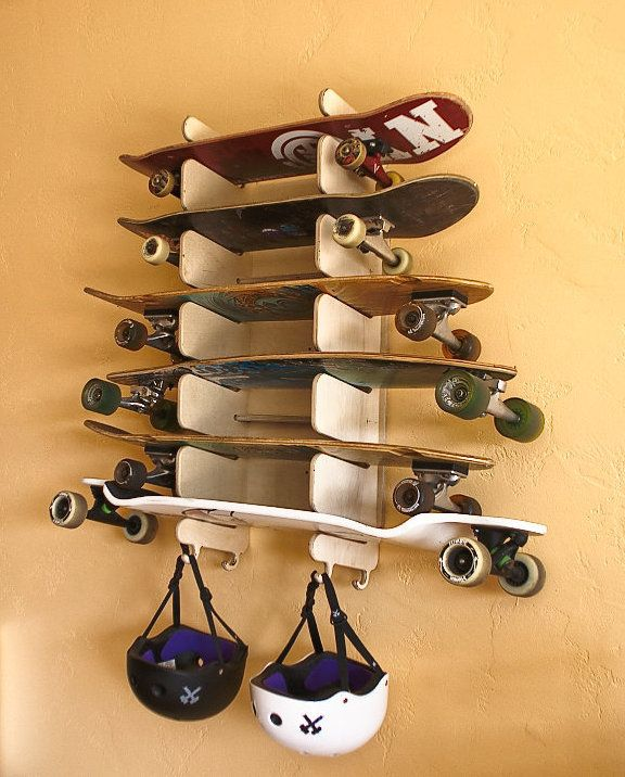 This 6 board rack is wall mounted and holds skateboards, longboards,  snowboards