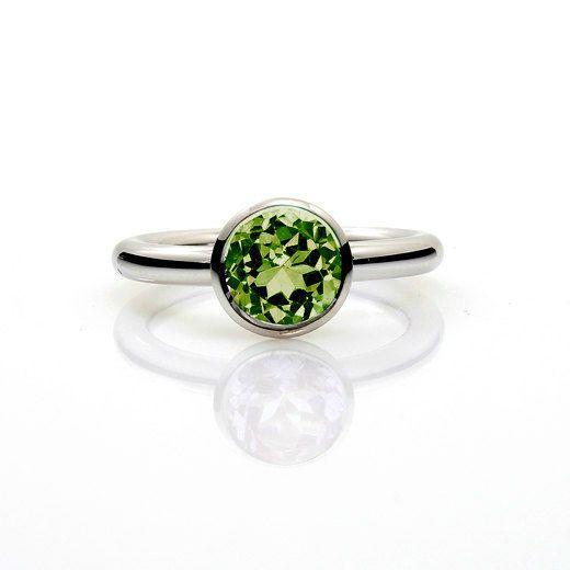 Peridot engagement rings made from white gold by TorkkeliJewellery, $1219.00