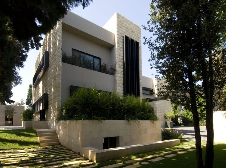 M & K House, located in Zouk el Khrab of the northern suburbs of Beirut, formerly existed as a simple double unit, two-story building of concrete with stone cladding on its side walls. The RAA approach towards the house's transformation included cle