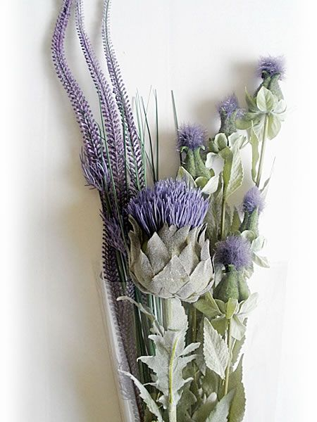 This beautifully balanced bouquet has a dominant large thistle flanked by a coterie of single smaller thistles and a foxtail against a green grass backdrop. A superb gift, which, although understated, is extremely classy and amply reflects the rugged, imposing terrain of Scotland's Central Highlands. http://www.thistleflowersusa.com/products/tf_bouquet_blairgowrie_lg.jpg