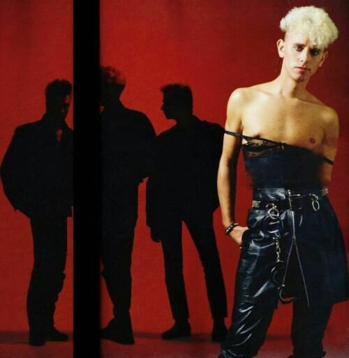 Depeche Mode shadowed with Martin L.Gore in the forefront right and visible. 1980s.