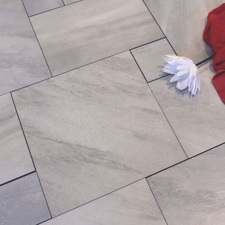 A Light Grey Coloured Multi Sized Combination Pack Containing Natural Stone Effect Porcelain
