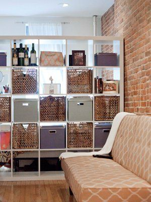 Use a cubby shelf as a privacy divider in a studio apartment.