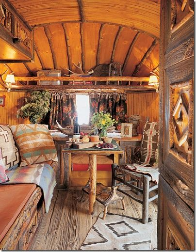 This smaller Airstream is actually located on Ralph Lauren's Double L ranch in Telluride, Colorado decorated with authentic rough wood in this indian motif.