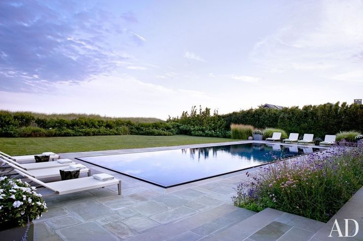 Just a stone's throw from the dunes in Sagaponack, New York, is a beach house that design firm Cullman & Kravis created for a Boston family in collaboration with architecture studio Ike Kligerman Barkley. Surrounding the infinity edge pool is a bluestone terrace that hosts teak chaise longues by Janus et Cie. Edmund Hollander Landscape Architects oversaw the grounds. William Waldron