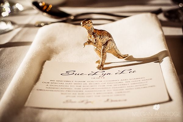 Gorgeous Gold Dinosaur place setting A wedding night at the museum – Melbourne Museum wedding