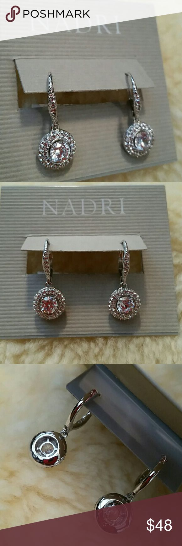 "Nadri Rhodium CZ crystal drop leverback earrings Nordstrom Nadri Rhodium CZ crystal drop leverback earrings 6mm prong set CZ framed with pave crystal encrusted circle dangles Crystal encrusted Euro-wire leverbacks Approx 1"" overall drop, 1/2"" diameter dangle Brand new and unused with earring card Will ship in a decorative organza giftbag Nadri Jewelry Earrings"