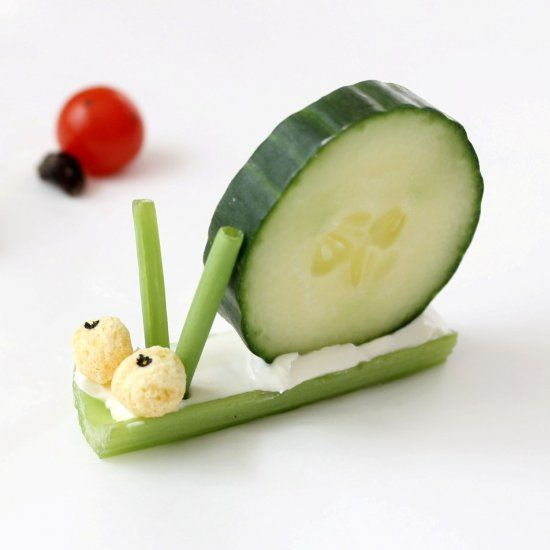 Simple, fun veggie bugs for kids made with vegetables, cereal and a black food pen.