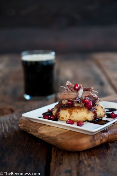 Duck Confit over Pale Ale Potato Cakes and Stout Pomegranate sauce