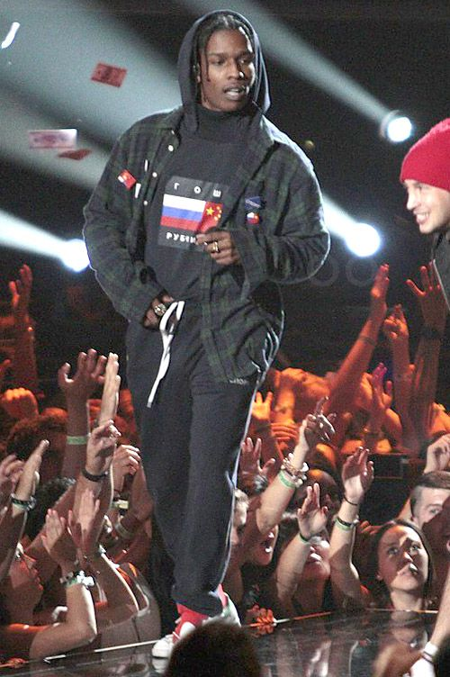 This is a picture of ASAP Rocky with the gosha rubchinskiy flag hoodie, its one of the iconic things from gosha rubchinskiy