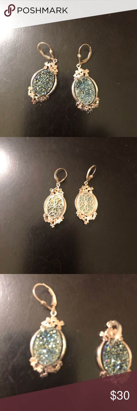 Beautiful multicolored Drusy earrings These measure over 1 1/2 inches long from the class to the end of the earrings. There are clovers around the top and the base of the Drusy.  I bought these and the QVC section of the jewelry, but I do not see .925 anywhere Jewelry Earrings