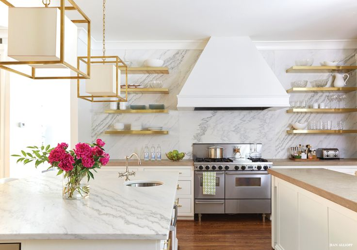 Brass floating shelves + marble slab backsplash