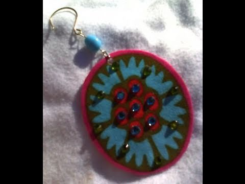 In this video you will learn how to make earrings using Amy Butler Fabric, fabric stiffener and embellishments.