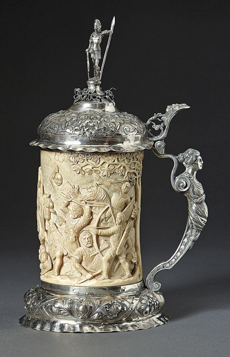 Silver mounted ivory beaker. Hanau, Gebrüder Gutgesell, early 19th century. Decorated with medieval battle scene. H. 32cm.