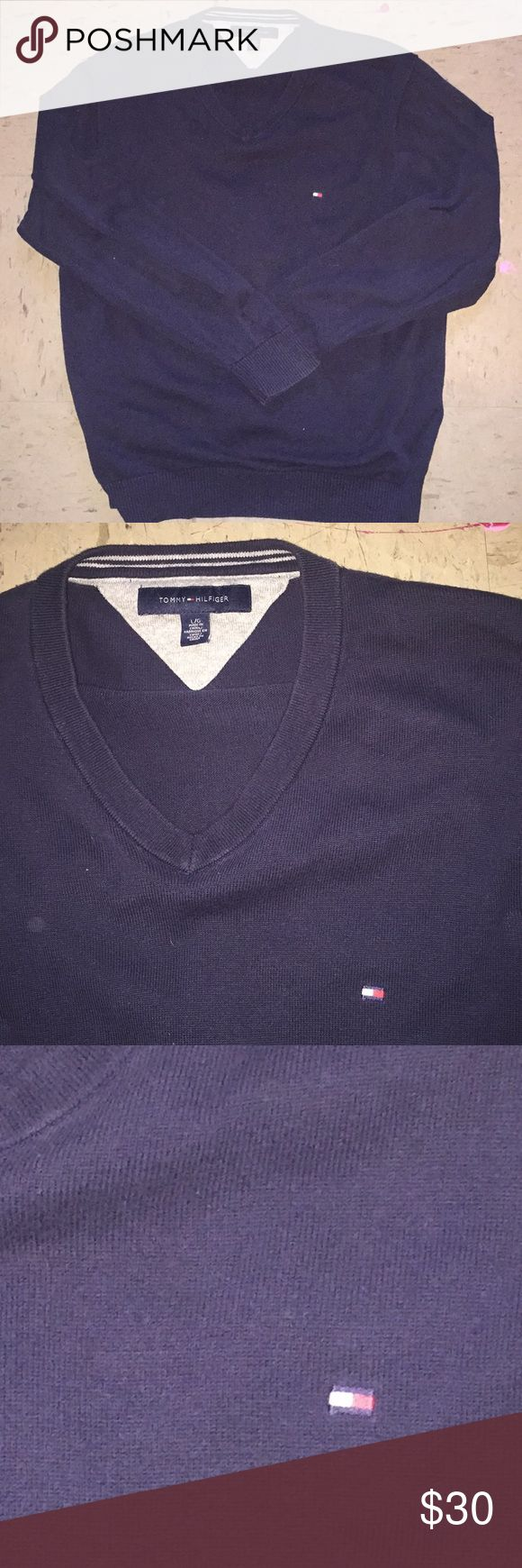 Tommy Hilfiger v-neck sweater a Tommy Hilfiger v-neck sweater in a dark blue. maybe darker than navy blue. small flag logo on the chest and is in a size large. Tommy Hilfiger Sweaters V-Neck