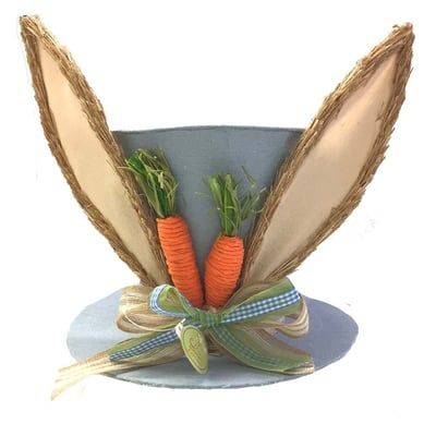 "Linen Bunny Ear Top Hat Color: Blue Size: Brim 9.5"" in width; hat 7"" in ht; 11"" to top of ears Fabric covered cardboard hat with grassy bunny ears. Decorated with carrots on the front and"