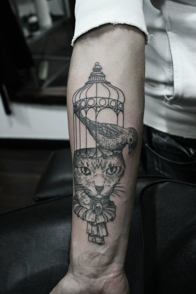 cat & bird with cage tattoo - Otto d'Ambra