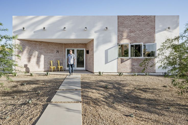 The front uses common materials to the neighborhood in a new modern way. A recessed front porch walls flare out as if to welcome the community