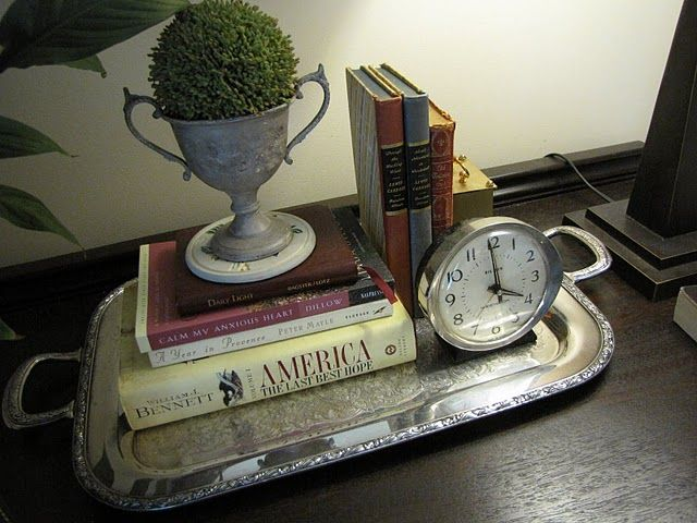 Vignette on a silver tray.  Great use for a silver tray.