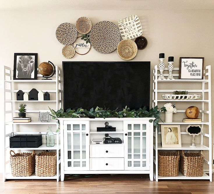 White entertainment center with basket wall. Styled