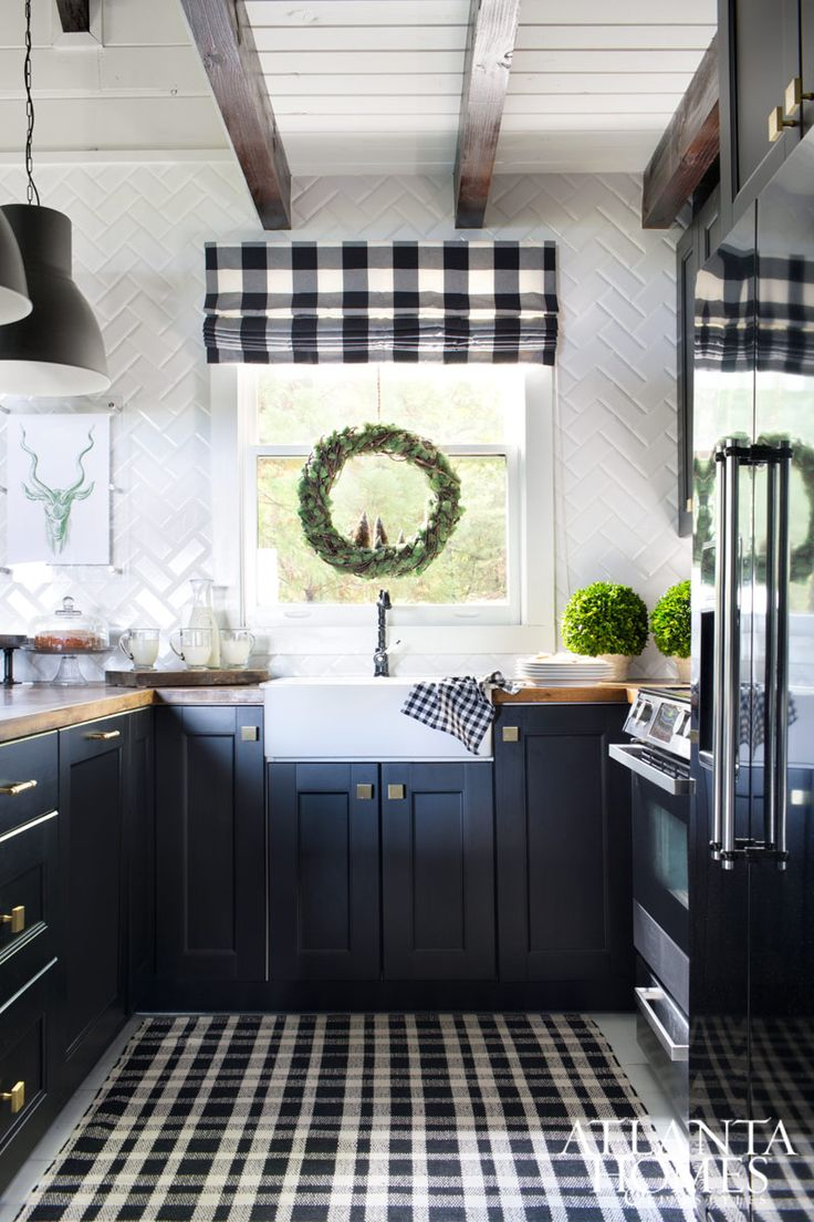 Design White And Black Kitchens best 25 blue white kitchens ideas on pinterest kitchen a woven vine and moss wreath adds natural appeal to the newly renovated kitchen