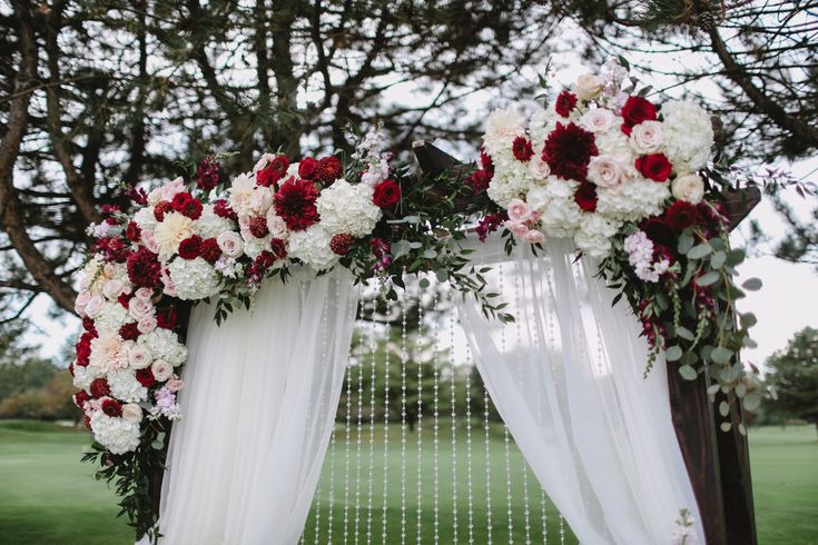 Wedding Photography in Windsor Ontario - Beautiful white and Burgundy Flower Garland Above the Bride and Groom Bench - Curescu Photography