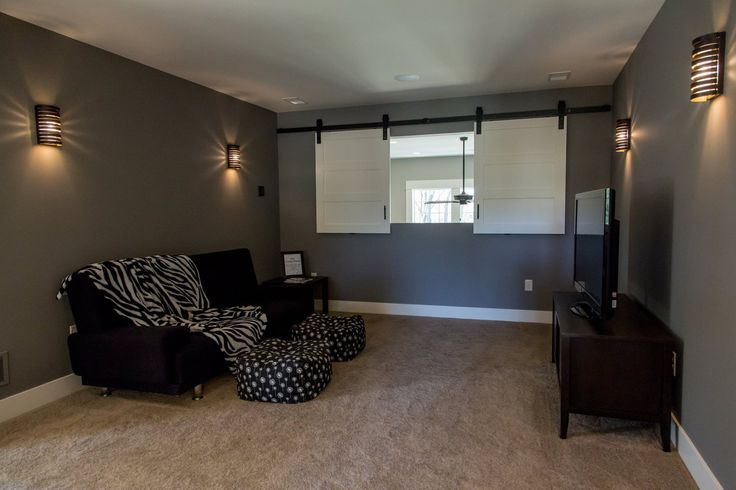 Custom made sliding windows transformed this loft space for Sliding barn door living room