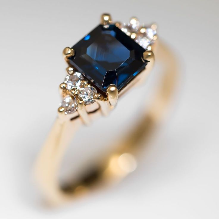 1.50 Carat Emerald Cut Blue Sapphire Ring 18K Gold (love but instead with silver and a black onyx stone!